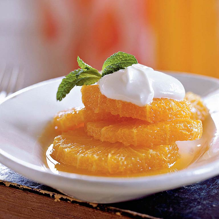 Oranges RecipeJuicy sliced oranges make a great dessert when they're drizzled with cardamom syrup and topped with a honey-sweet Greek yogurt mixture. This low-fat dessert is not only high in potassium, but also high in vitamin C and low in fat and sodium.