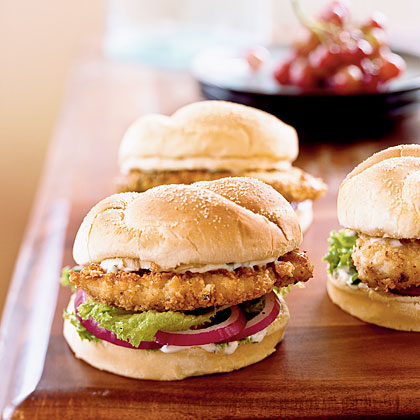 "Coat boneless chicken breast halves in crushed tortilla chips and pan-fry them for pieces of crispy, low-fat ""fried"" chicken.Spicy Chicken Sandwiches Recipe"