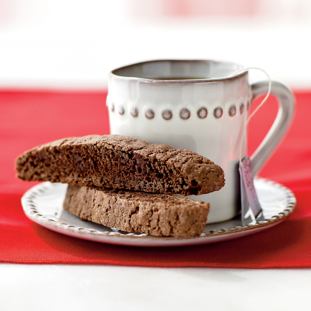 Double-Chocolate Biscotti RecipeVanilla extract enhances the dusky mix of cocoa and mini-chips in these twice-baked slice cookies, which deliver deep chocolate taste.