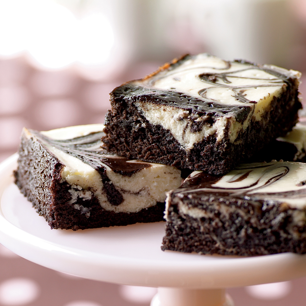 Peppermint Cheesecake Brownies RecipeFudgy brownies get a decadent top layer of swirled cheesecake and brownie batter in these over the top bars. Raspberry extract also works well as a flavoring.