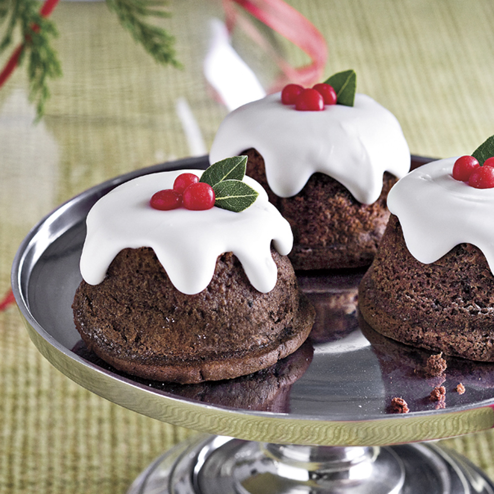 Snowy Chocolate Baby Cakes RecipeMake these mini chocolate cakes by starting with a devils' food cake mix and baking in muffin pans.  The festive holly garnish is simply red cinnamon candies and fresh bay leaves.