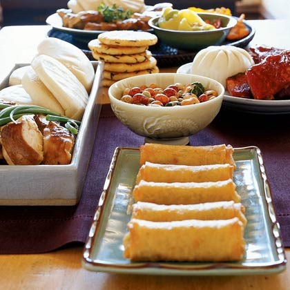 Asian buffet with spring rolls and roasted nuts