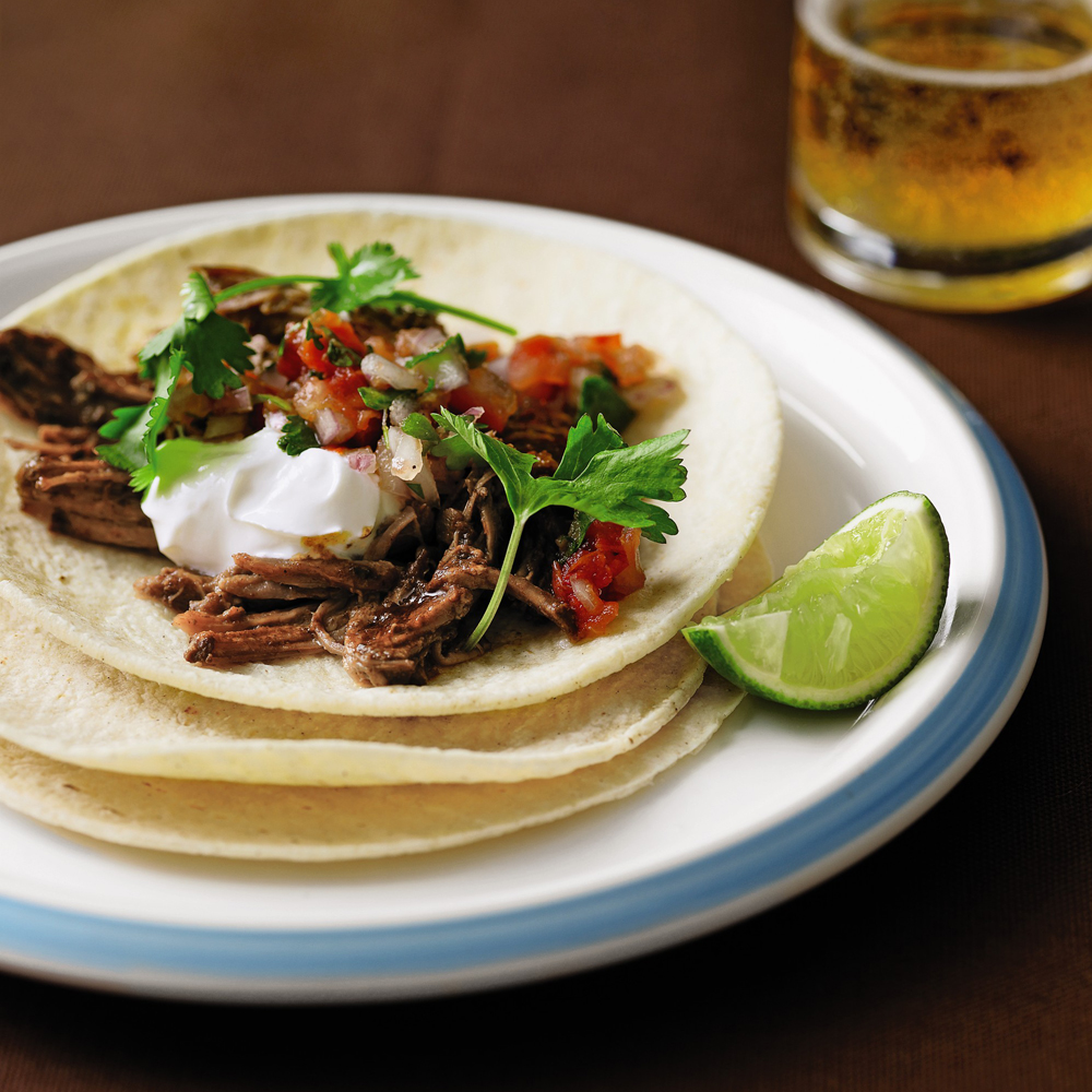 Pulled-Pork Tacos RecipeTacos are always a great summer meal you can eat with your hands. In this recipe, your pork gets perfectly tender and shreddable in the slow cooker.
