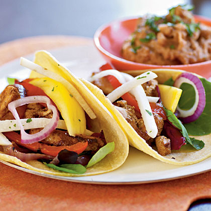 Add fresh fruits and vegetables to spicy chicken tacos for an inspired Mexican meal.d fresh fruits and vegetables to spicy chicken tacos for an inspired Mexican meal.Fiesta Chicken Tacos