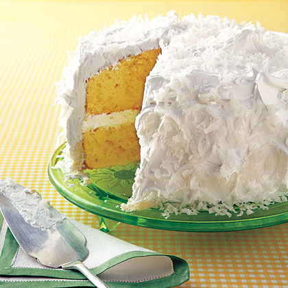 Coconut Cake RecipeThis classic two-layer coconut cake recipe features a homemade frosting made from  sugar, lemon juice, egg whites, vanilla extract, and shredded coconut.