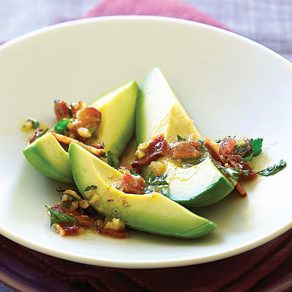 Avocados with Warm Bacon Parsley Vinaigrette RecipeCrunchy bacon brings out the smokiness of a good Hass avocado, and the sharp vinaigrette helps cut its richness.
