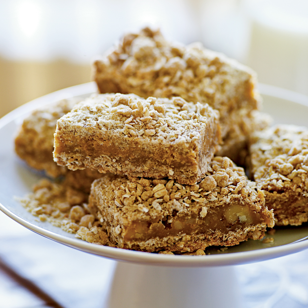 Butterscotch Bars RecipeCondensed milk and butterscotch morsels melt together to make a gooey center for these streusel topped bars.