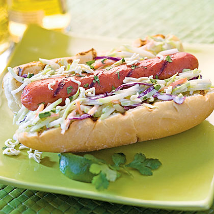 Asian Slaw Dogs RecipeSkip the traditional mustard-and-ketchup toppings and instead top your dogs with Asian-inspired flavors including broccoli slaw, fresh ginger, and hoisin sauce. Theme your buffet towards flavors of the East for a fun twist during your turn to host the tailgating event.