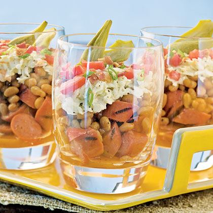 Layered BBQ Salads With Grilled Hot Dogs RecipeFor an appetizer that's as cute as it is delicious, layer your favorite game-day ingredients, including baked beans, coleslaw, and hot dogs, in individual glasses. Garnish with picked okra, for a southern touch, or a sliced pepper, for bold Midwestern flavor.
