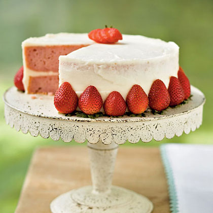 Garnish this strawberry layer cake with fresh strawberry halves for a pretty presentation. You can use fresh orange juice instead of Grand Marnier in the cream cheese frosting.Strawberry Layer Cake Recipe