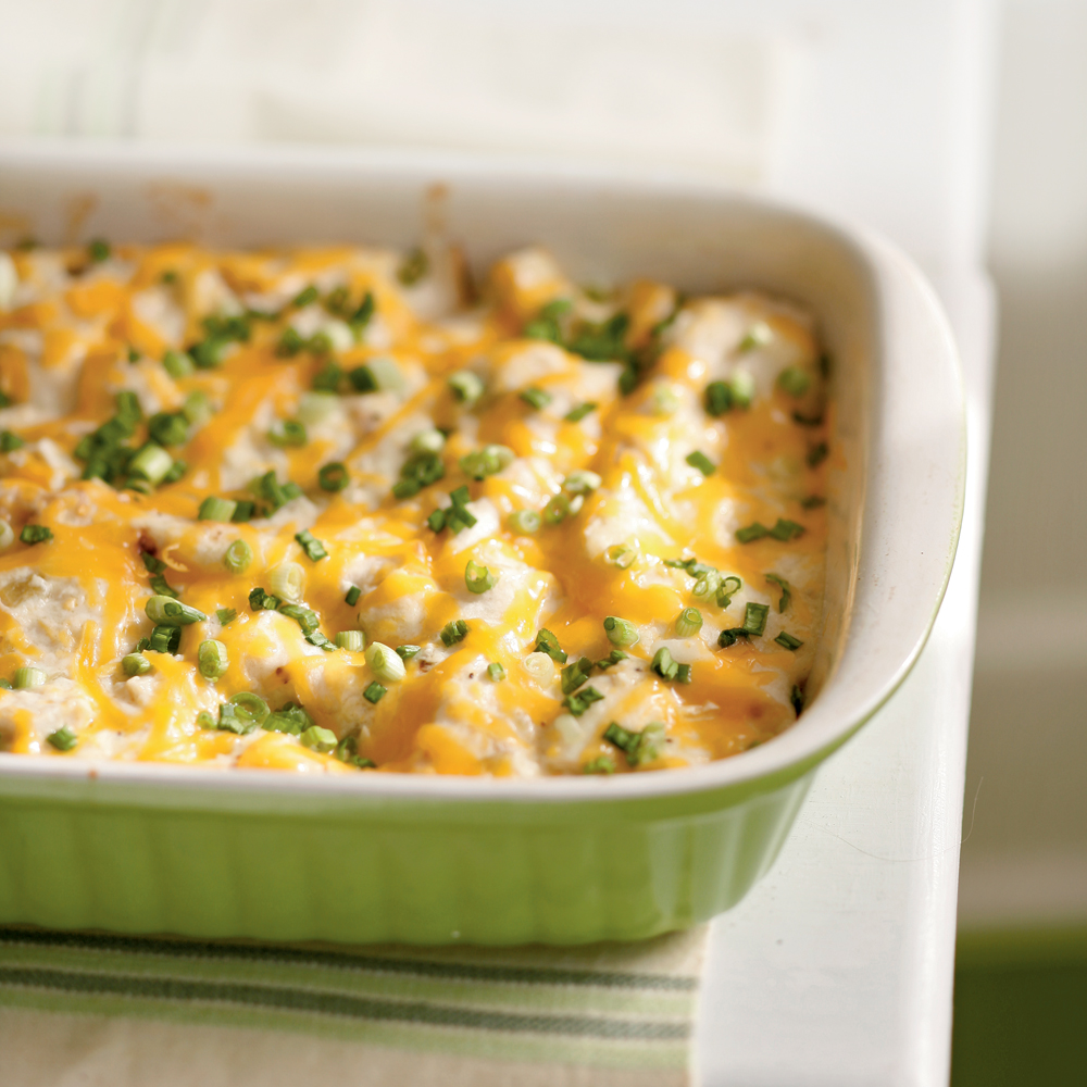 Trade the traditional enchilada sauce for a creamy, cheesy topping on this 40-minute Mexican chicken casserole. Your family will never know they're enjoying a lightened meal.Cheesy Chicken Enchiladas