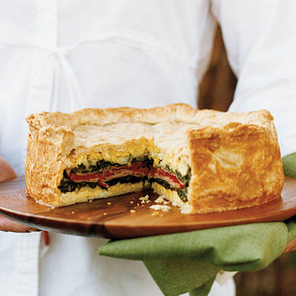 Layered Torta with Ham, Provolone, Spinach, and Herbs Recipe