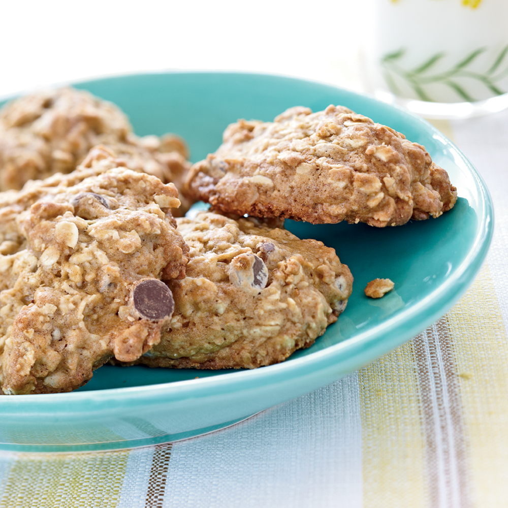 Banana-Oatmeal Chocolate Chip Cookies RecipeMashed banana adds rich flavor and moistness to these cookies.