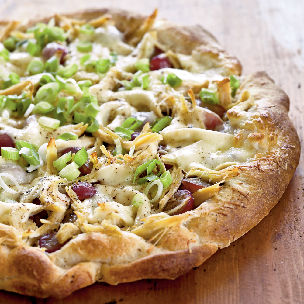 Chicken, Red Grape, and Pesto Pizza RecipeGrapes make an ideal salad topping, but what about on pizza...? This surprising addition is a sweet contrast to the tangy Romano cheese, herby pesto, and juicy chicken.