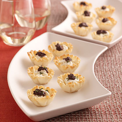 Goat Cheese-and-Olive Mini Tarts RecipeUse frozen mini phyllo pastry shells, goat cheese and storebought olive tapenade to make these quick and easy 5-ingredient appetizers.