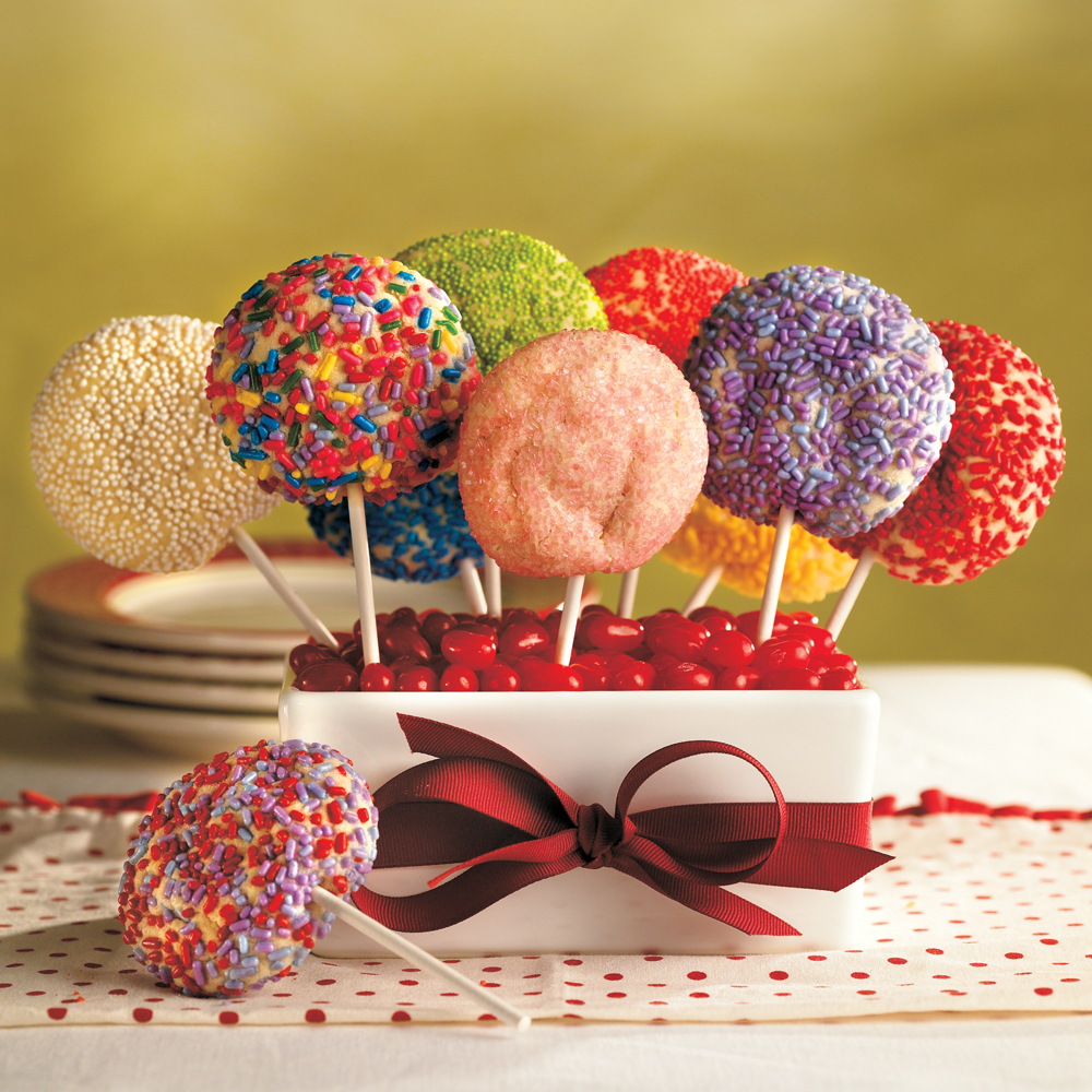 Sugar Cookie Pops RecipeLet your kids get in on the action with these colorful cookie pops. They can roll cookie dough balls in their favorite sprinkles and colored sugar and help you stick each cookie on a craft stick to complete the look.