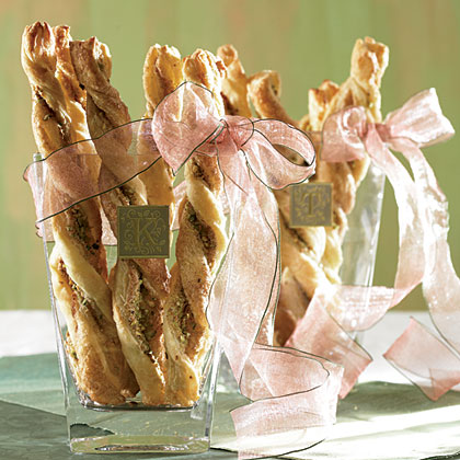 Pistachio Pastry Twists RecipeGive your guests something crisp and delicious to munch on while they debate today's starting line. Verticle presentation saves you room for large platters of other noshes.