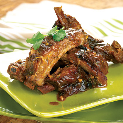 Thai-Style Ribs RecipeWith these appetizer ribs, there will be no more long hours of smoking on the grill or smoker. The slow cooker cuts the time in half while still yielding that much desired fall-off-the-bone texture. Cutting the rib racks in half makes a better appetizer-sized portion.