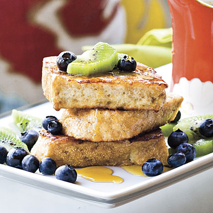 Guiltless French Toast RecipeThis lightened version of French toast is made with egg whites instead of whole eggs, orange juice and whole wheat bread and has less than 5 grams of fat per serving.