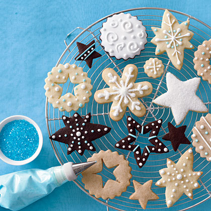 "Everyone brings ""bare"" cookies like sugar cookies, shortbread, or gingerbread. The host provides decorations, such as frostings, sprinkles, melted chocolate, toasted coconut, or chopped nuts, and guests decorate their own custom cookies.Christmas Cookies 4 Ways"