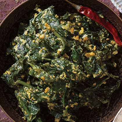 Spinach Simmered in Yogurt RecipeCreamy spinach takes a trip to the Mediterranean with the addition of bold-flavored seasonings including red chili, garlic, coriander, and turmeric. Yogurt tames the spices to make it a great last-minute side dish for roasted meats.