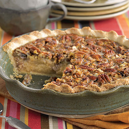 Pecan-Grits Pie RecipeYou can get much more Southern than grits and pecans, so why not combine them in a decadent dessert? The grits actually add texture to the sugary pecan filling and are also used in the cornmeal crust.