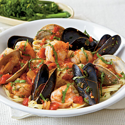 "Italian for ""angry,"" arrabbiata is a spicy tomato sauce. For true fury, use crushed red pepper in this seafood dish.Seafood Arrabbiata