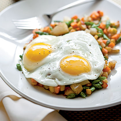 Day-After-Thanksgiving Hash RecipeTurn your Thanksgiving leftovers into a hearty hash and top with eggs for a one-dish breakfast meal.