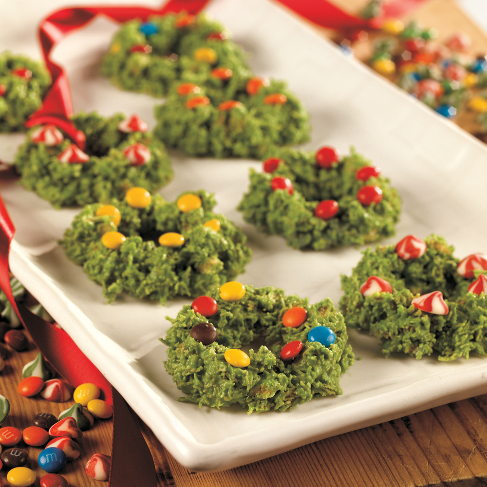 Wreath Cookies RecipeWith only a few ingredients, you can transform shredded wheat cereal into these whimsical holiday wreaths. Let the kids help shape and decorate them with cinnamon candies, M&Ms, or crushed peppermints.