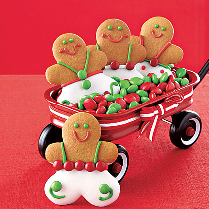 Gingerbread Cookies RecipeThese little gingerbread men are almost too cute to eat! Give them personality with chocolate candies and colored icing.