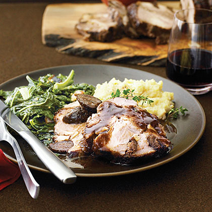 Pork Shoulder Roast with Figs, Garlic, and Pinot Noir RecipeStuffing this roast with figs and garlic slivers will make you feel like a modern-day Julia Child, and the results are stunning: mosaic-like slices infused with rich fruit and wine flavors.
