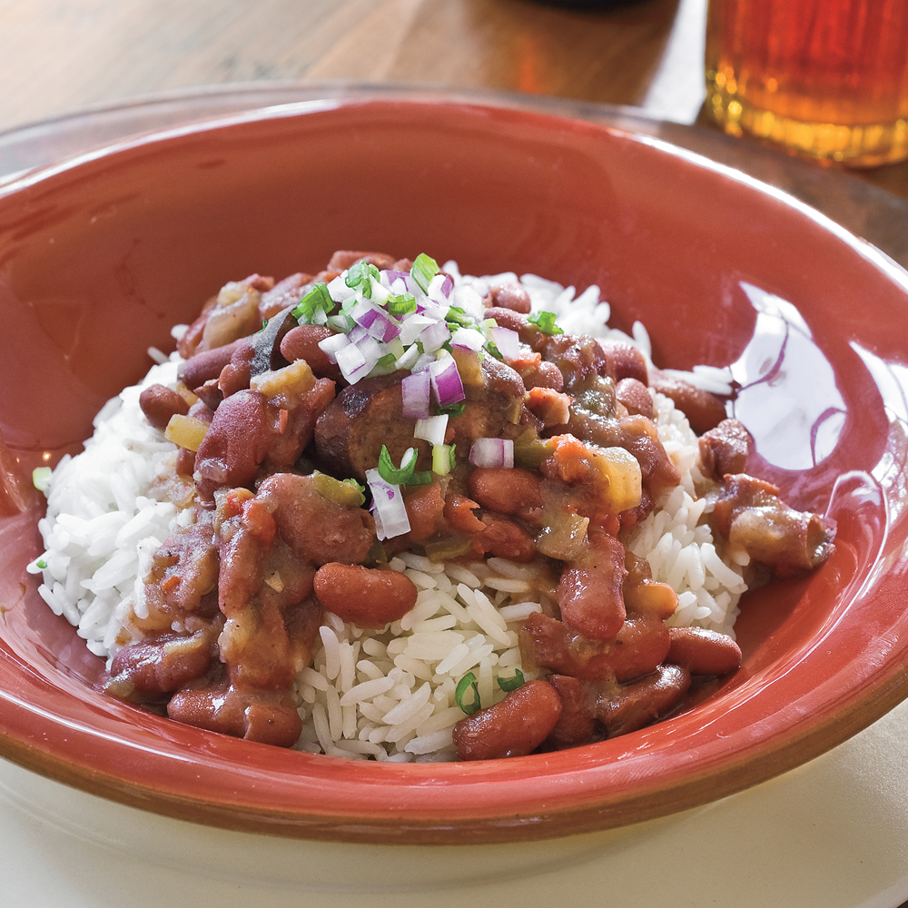 Smoked turkey sausage, bell peppers, and red beans come together in this classic, easy slow-cooker recipe. Serve over long-grain rice for an amazing meal.Slow Cooker Red Beans and Rice