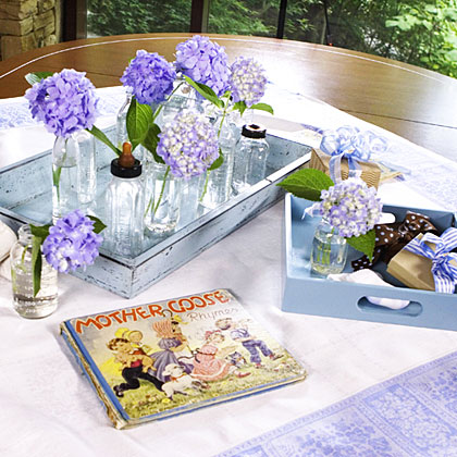 Party hostesses or the guest of honor's family can bring a special treasure from childhood–favorite books, baby booties, rattles to dress up a conference room table and serve as conversation starters. Pretty blue trays, ribbons, or a tablecloth make a plain office table party pretty.