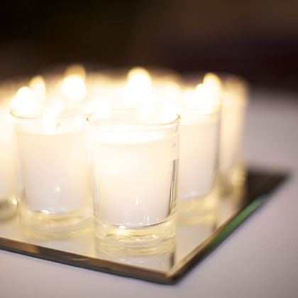 Make use of your holiday lights and decorations–put shiny holiday ornaments into clear vases. Since Paris is the City of Lights, anything shiny and sparkling is perfect. Votive candles arranged on an inexpensive square mirror from the craft store adds that wow factor you want for your table.