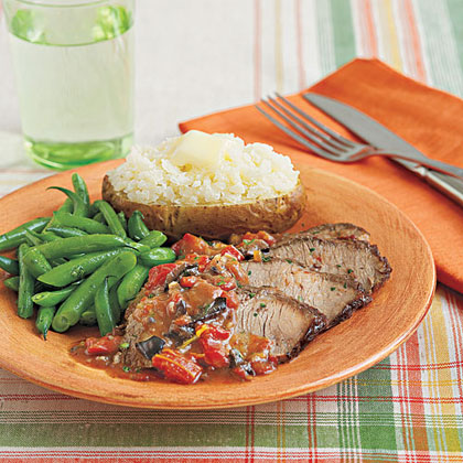 Mediterranean Brisket RecipeCooking brisket is easy when a slow-cooker is involved! This simple recipe takes just 5 minutes to prepare–you don't even need to brown the beef first. Serve with steamed green beans and a baked potato for a super-filling supper.