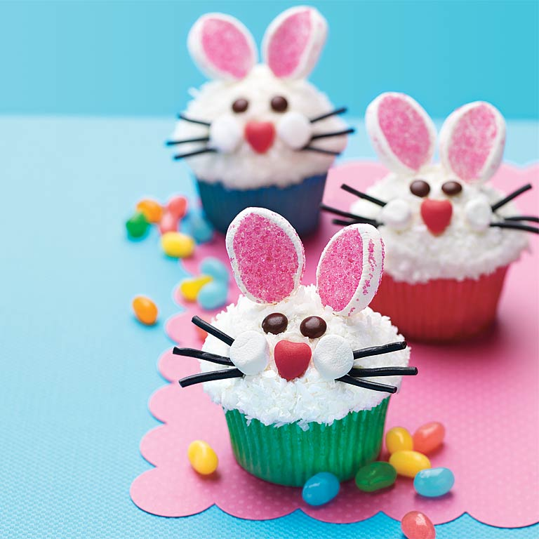 These super cute Bunny Face Cupcakes are fun and easy to decorate. You can use your favorite cupcake recipe as the base, then top it with frosting, coconut, marshmallows, pretzels and an assortment of candy.Bunny Face Cupcakes