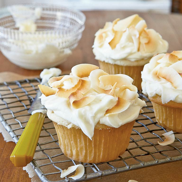 Create a memorable dessert packaged in a pint-size liner. These too-cute-to-eat treats get their vibrant flavor from coconut extract.Coconut Cupcakes with Coconut-Cream Cheese Frosting Recipe