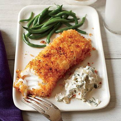 Panko is the secret ingredient that makes these oven-fried fish fillets a family favorite. For best results, use Alaskan cod, halibut, or even tilapia for this 30-minute fish supper.Crispy Fish with Lemon-Dill Sauce