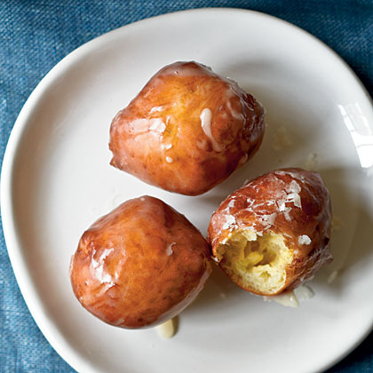 Maple-Glazed Sour Cream Doughnut Holes RecipeSour cream enriches these yeasted doughnut holes and the maple glaze provides an added sweetness. Enjoy them for breakfast or dessert.