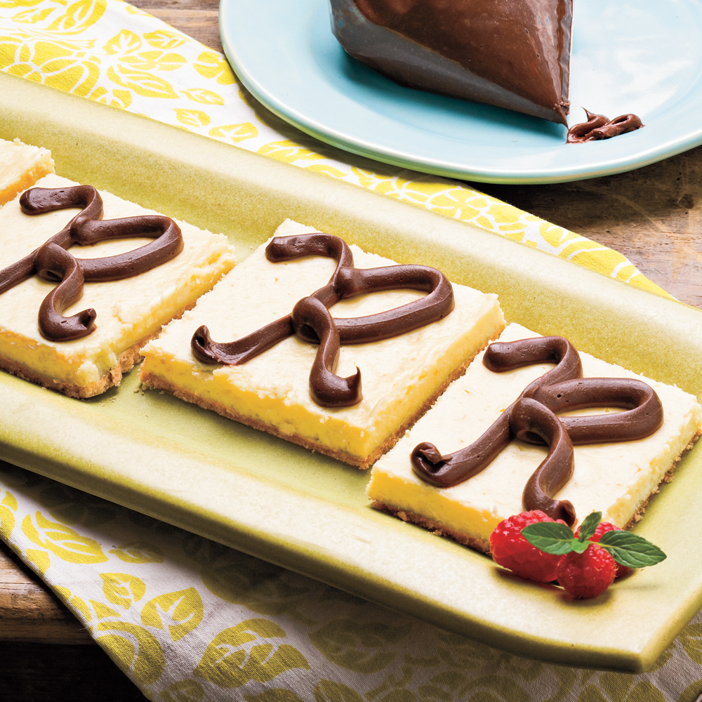 Easy Cheesecake Bars RecipeYour guests will never know how easy these bars were to make! If you like, use chocolate frosting to pipe holiday shapes on the top.