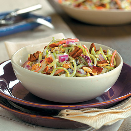 Broccoli Slaw Salad RecipeInstead of cabbage, this salad recipe uses broccoli slaw, and it features the typical ingredients used in a broccoli salad: raisins, bacon, onion, and a creamy mayonnaise-based dressing.