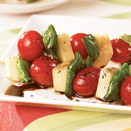 Caprese Skewers RecipeA Caprese salad is a made from tomatoes, fresh mozzarella, fresh basil, and olive oil. We've taken similar ingredients and threaded them onto wooden skewers to create handheld appetizers.