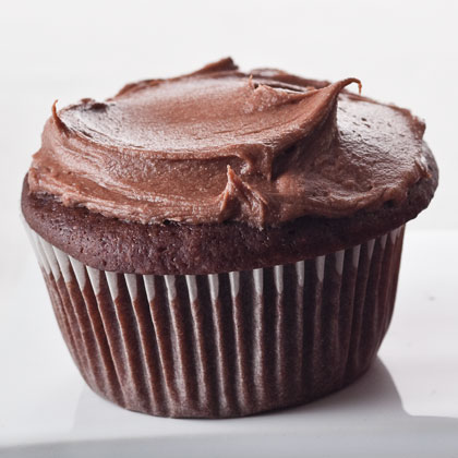 Choco-Sour Cream Cupcakes RecipeThe additions of sour cream and buttermilk add moistness to these chocolate cupcakes with milk chocolate-cream cheese frosting