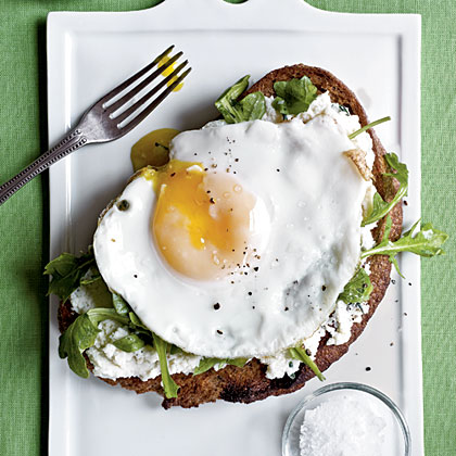 <p>Open-Faced Sandwiches with Ricotta, Arugula, and Fried Egg</p>