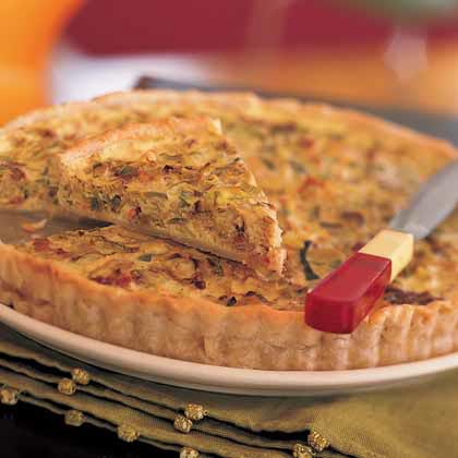 Leek-and-Bacon Tart RecipeThis lighter version of a quiche Lorraine features a reduced-fat pie crust, egg substitute, and fat-free milk. Like the traditional recipe, it still contains bacon, and it calls for milder-flavored leeks instead of onions.