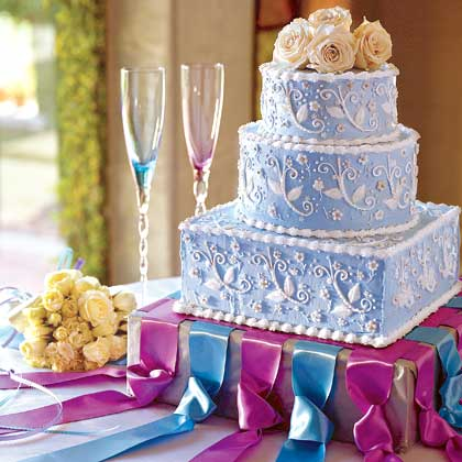 Inspired by ribbons and lace and reminiscent of fine china, this cake will be the focal point of your reception. The cake layers are classic and generously coated with a sumptuous apricot glaze that complements the amaretto batter and the buttercream frosting. Recipe: Amaretto Cream Wedding Cake
