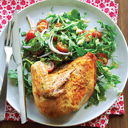 Freshen up a simple roasted chicken by serving it over a bed of arugula, fresh herbs, cherry tomatoes and feta cheese.Roast Chicken with Arugula Tomato Salad Recipe