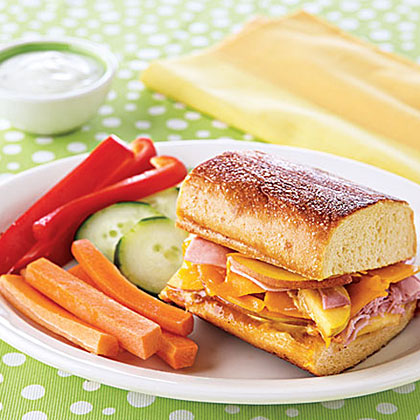 Grilled Ham, Peach and Cheddar Sandwiches RecipeGive plain ham a lift by spreading a mixture of mustard and peach jam over the slices and topping them with sliced peaches and Cheddar cheese.