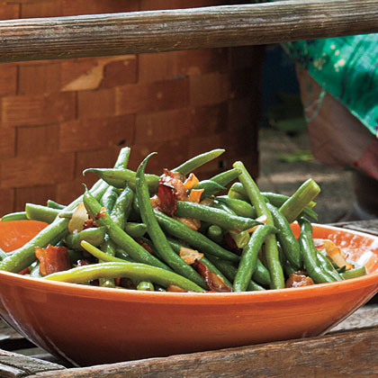 Instead of green bean casserole, go with a simpler dish featuring beans flavored with bacon, onion, sugar, and cider vinegar.Sweet-and-Sour Green Beans Recipe