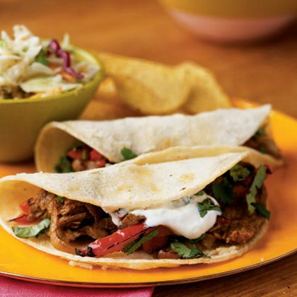 Bring the Tacqueria Home MenuPile garlicky strips of beef, onion, and peppers into warm corn tortillas for a zesty weeknight dinner, and serve salsa and chips on the side.